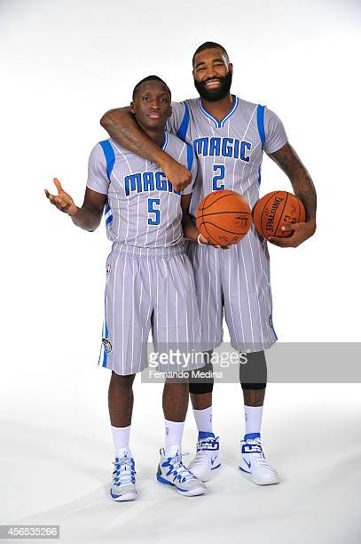 Victor Oladipo and Kyle O'Quinn of the Orlando Magic pose for a portrait at Orlando Magic Media Day on September 29 2014 at Amway Center in Orlando...