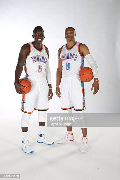 Victor Oladipo and Russell Westbrook of the Oklahoma City Thunder pose for a portrait during 2016 NBA Media Day on September 23 2016 at the...