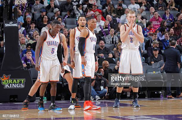 Victor Oladipo Andre Roberson Russell Westbrook and Domantas Sabonis of the Oklahoma City Thunder look on during the game against the Sacramento...