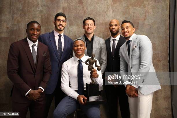 Victor Oladipo Ends Kanter Nick Collison Taj Gibson and Andre Roberson poses with Russell Westbrook of the Oklahoma City Thunder after receiving the...