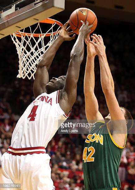 Victor Oladipo of the Indiana Hoosiers and Marshall Bjorklund the North Dakota State Bison reach for a rebound during the game at Assembly Hall on...