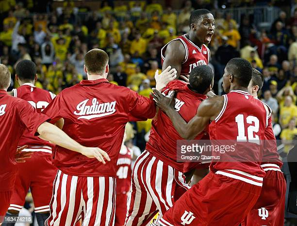 Victor Oladipo of the Indiana Hoosiers celebrates a 7271 victory over Michigan Wolverines with teammates at Crisler Center on March 10 2013 in Ann...