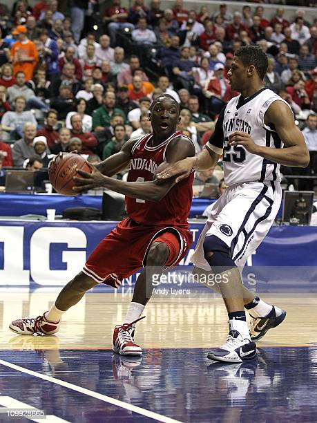 Victor Oladipo of the Indiana Hoosiers drives against Jeff Brooks of the Penn State Nittany Lions during the first round of the 2011 Big Ten Men's...
