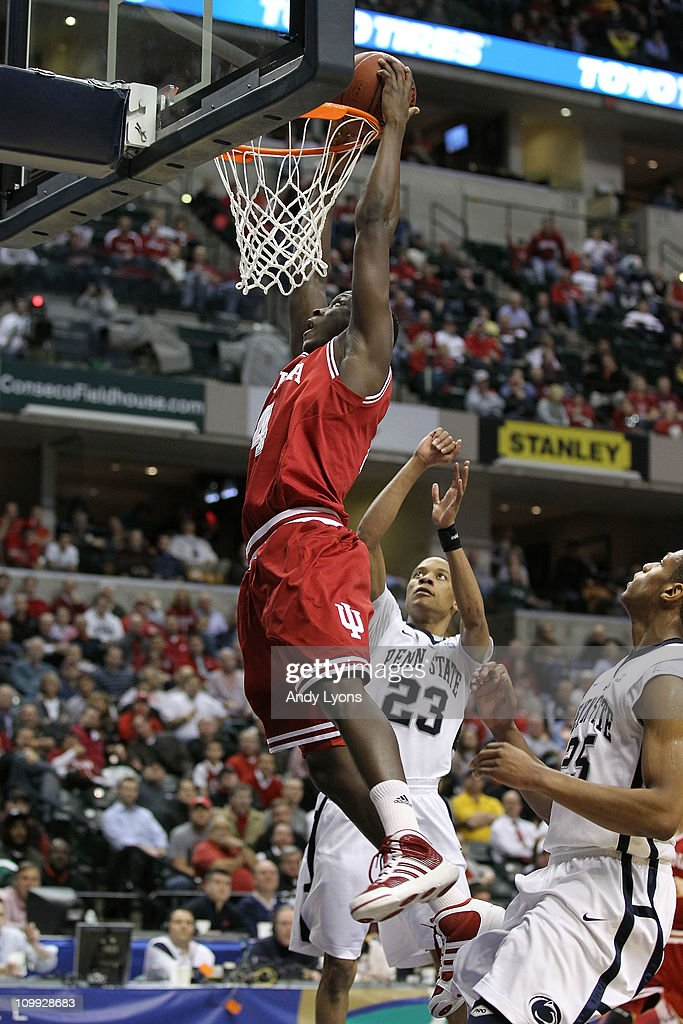 Victor Oladipo #4 of the Indiana Hoosiers dunks against Tim Frazier #23 of the Penn State Nittany Lions during the first round of the 2011 Big Ten Men's Basketball Tournament at Conseco Fieldhouse on March 10, 2011 in Indianapolis, Indiana.