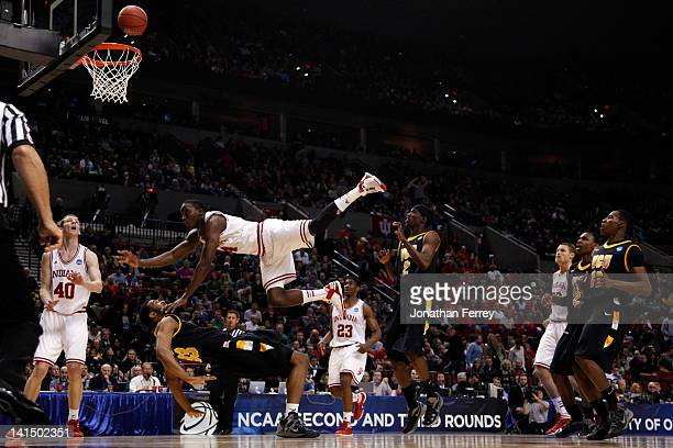 Victor Oladipo of the Indiana Hoosiers is called for a charge against D.J. Haley of the Virginia Commonwealth Rams in the first half during the third...