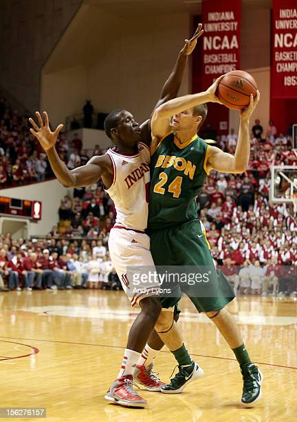 Victor Oladipo of the Indiana Hoosiers puts defensive pressure on Taylor Braun of the North Dakota State Bison reach for a rebound during the game at...