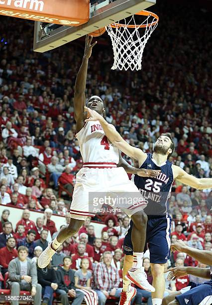 Victor Oladipo of the Indiana Hoosiers shoots the ball while defended by Pablo Bertone of the Florida Atlantic Owls during the game at Assembly Hall...