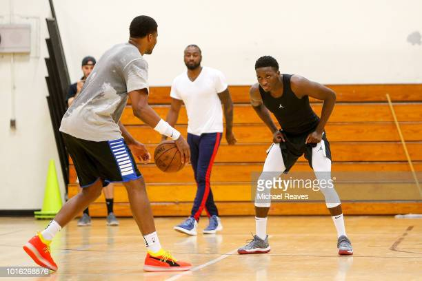 Victor Oladipo of the Indiana Pacers and John Wall of the Washington Wizards guard Rudy Gay of the San Antonio Spurs during NBA Offseason training...