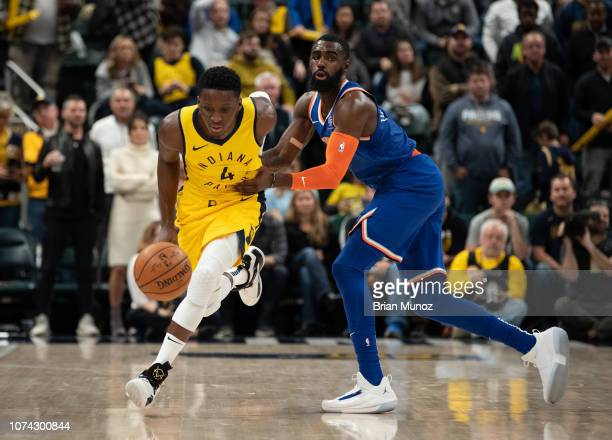 Victor Oladipo of the Indiana Pacers attempts to push past Tim Hardaway Jr #3 of the New York Knicks during the second half of the game against at...
