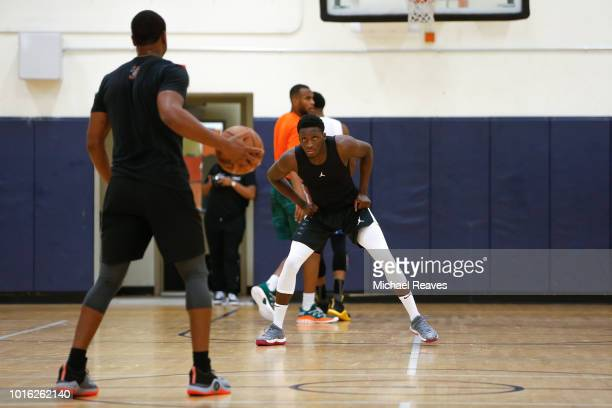 Victor Oladipo of the Indiana Pacers defends Dwyane Wade of the Miami Heat during NBA Offseason training with Remy Workouts on August 8 2018 in Miami...