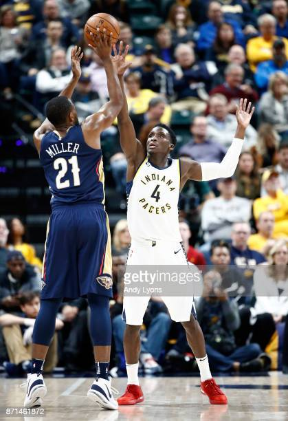 Victor Oladipo of the Indiana Pacers defends the shot of Darius Miller of the New Orleans Pelicans at Bankers Life Fieldhouse on November 7 2017 in...