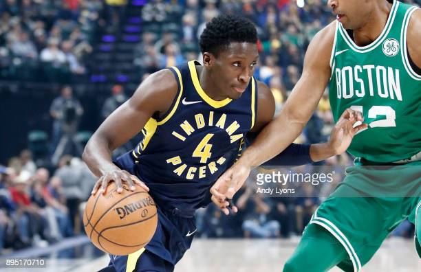 Victor Oladipo of the Indiana Pacers dribbles the ball during the game against the Boston Celtics at Bankers Life Fieldhouse on December 18 2017 in...