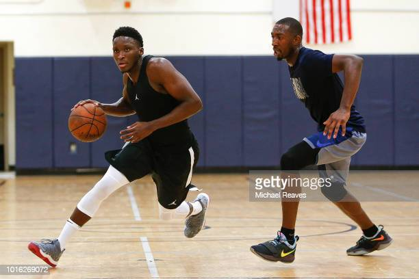 Victor Oladipo of the Indiana Pacers drives to the basket against Davon Reed of the Phoenix Suns during NBA Offseason training with Remy Workouts on...