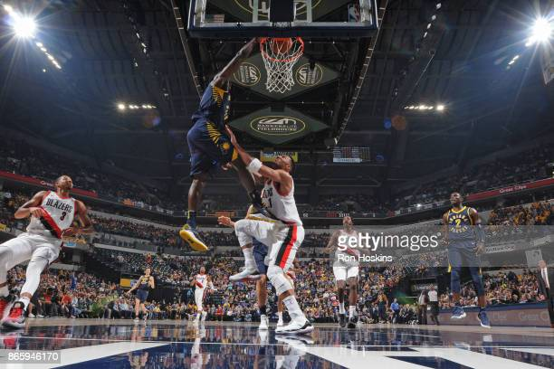 Victor Oladipo of the Indiana Pacers dunks the ball against Evan Turner of the Portland Trail Blazers on October 20 2017 at Bankers Life Fieldhouse...