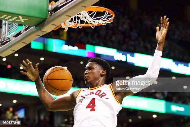 Victor Oladipo of the Indiana Pacers dunks the ball during a game against the Boston Celtics at TD Garden on March 11 2018 in Boston Massachusetts...