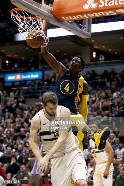 Victor Oladipo of the Indiana Pacers dunks the ball over Tyler Zeller of the Milwaukee Bucks in the third quarter at the Bradley Center on March 2...