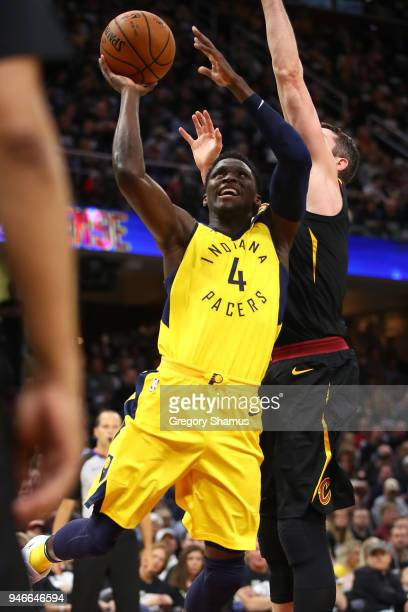 Victor Oladipo of the Indiana Pacers gets off a shot in front of Kevin Love of the Cleveland Cavaliers during the first half in Game One of the...