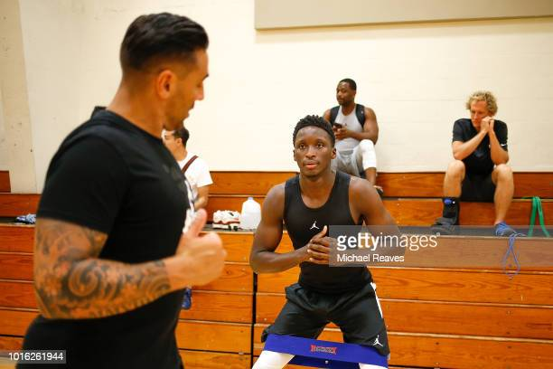 Victor Oladipo of the Indiana Pacers goes through stretches with DBC Fitness trainer David Alexander during NBA Offseason training with Remy Workouts...