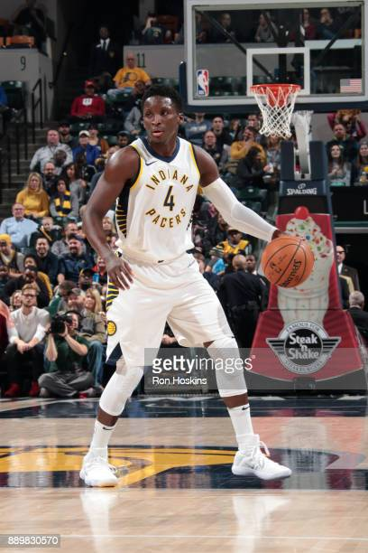 Victor Oladipo of the Indiana Pacers handles the ball during the game against the Denver Nuggets on December 10 2017 at Bankers Life Fieldhouse in...