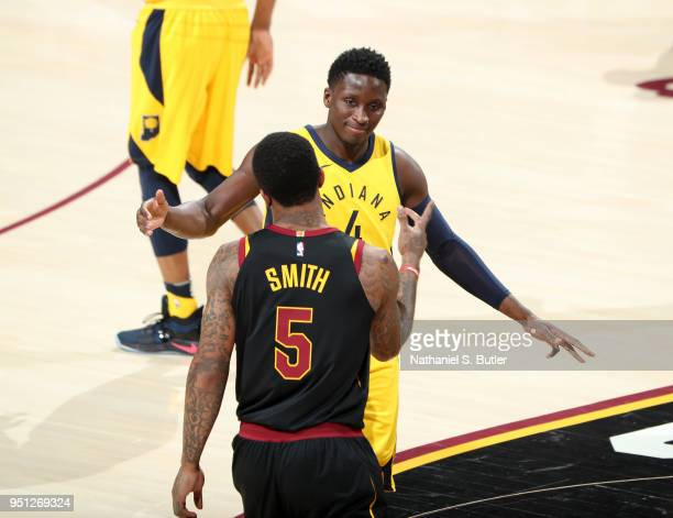 Victor Oladipo of the Indiana Pacers high fives JR Smith of the Cleveland Cavaliers in Game Five of Round One of the 2018 NBA Playoffs on April 25...