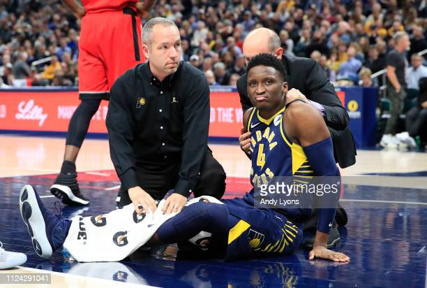 Victor Oladipo of the Indiana Pacers is attended to by medical staff after being injured in the second quarter of the game against the Toronto...
