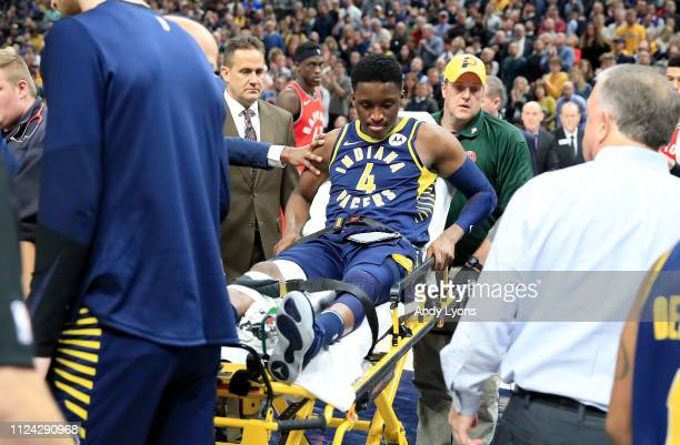 Victor Oladipo of the Indiana Pacers is taken off of the court on a stretcher after being injured in the second quarter of the game against the...