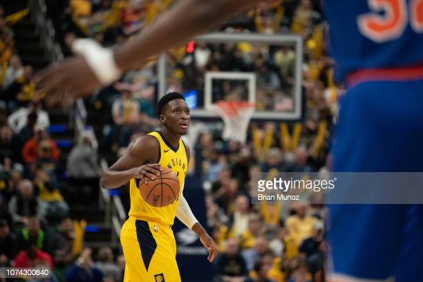 Victor Oladipo of the Indiana Pacers looks to the crowd as the game clock advances during the game against the New York Knicks at Bankers Life...