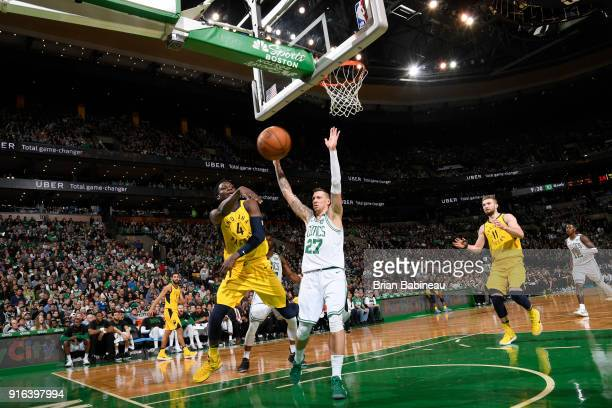 Victor Oladipo of the Indiana Pacers passes the ball against Daniel Theis of the Boston Celtics on February 9 2018 at the TD Garden in Boston...