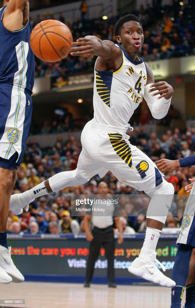 Victor Oladipo #4 of the Indiana Pacers passes the ball off during the game against the Denver Nuggets at Bankers Life Fieldhouse on December 10, 2017 in Indianapolis, Indiana.