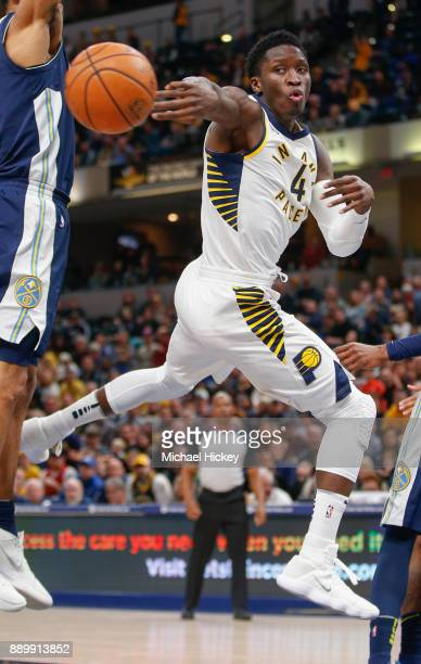 Victor Oladipo of the Indiana Pacers passes the ball off during the game against the Denver Nuggets at Bankers Life Fieldhouse on December 10 2017 in...