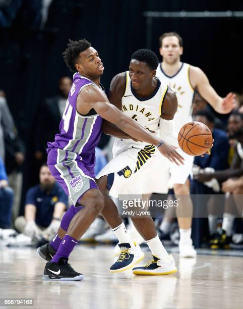 Victor Oladipo of the Indiana Pacers passes the ball while defended by Buddy Hield of the Sacramento Kings at Bankers Life Fieldhouse on October 31...