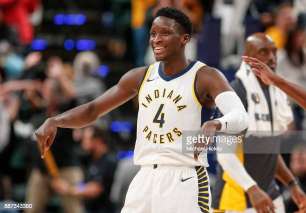 Victor Oladipo of the Indiana Pacers points to the court in celebration during the game against the Chicago Bulls at Bankers Life Fieldhouse on...