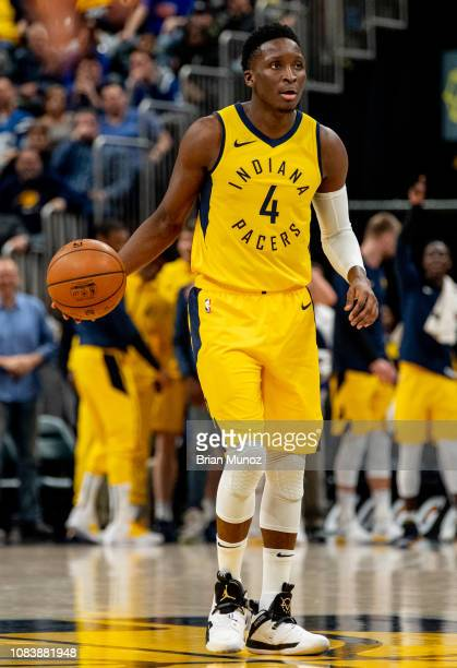 Victor Oladipo of the Indiana Pacers pushes the ball up the court during a game against the New York Knicks at Bankers Life Fieldhouse on December 16...