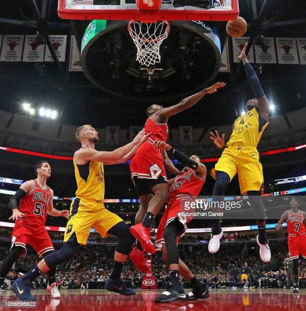 Victor Oladipo of the Indiana Pacers shoots over Chandler Hutchison and Cristiano Felicio of the Chicago Bulls on his way to a gamehigh 25 points at...