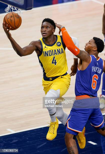 Victor Oladipo of the Indiana Pacers shoots the ball against Elfrid Payton of the New York Knicks during the first half at Bankers Life Fieldhouse on...