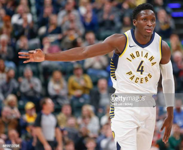 Victor Oladipo of the Indiana Pacers signals a three point basket during the game against the Denver Nuggets at Bankers Life Fieldhouse on December...