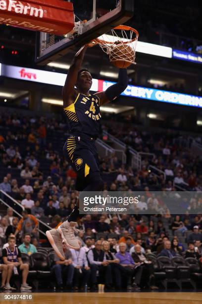 Victor Oladipo of the Indiana Pacers slam dunks the ball against the Phoenix Suns during the first half of the NBA game at Talking Stick Resort Arena...