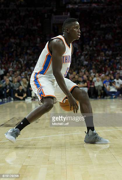 Victor Oladipo of the Oklahoma City Thunder dribbles the ball against the Philadelphia 76ers at Wells Fargo Center on October 26 2016 in Philadelphia...
