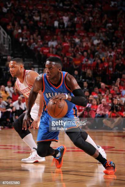 Victor Oladipo of the Oklahoma City Thunder handles the ball against the Houston Rockets during Game Two of the Western Conference Quarterfinals of...
