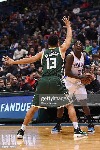 Victor Oladipo of the Oklahoma City Thunder is defended by Malcolm Brogdon of the Milwaukee Bucks during the second half of a game at the BMO Harris...