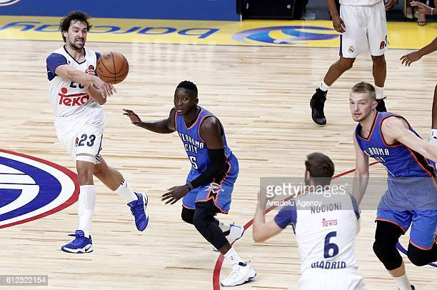 Victor Oladipo of the Oklahoma City Thunder is in action against Sergio Llull of Real Madrid during the basketball match between Oklahoma City...