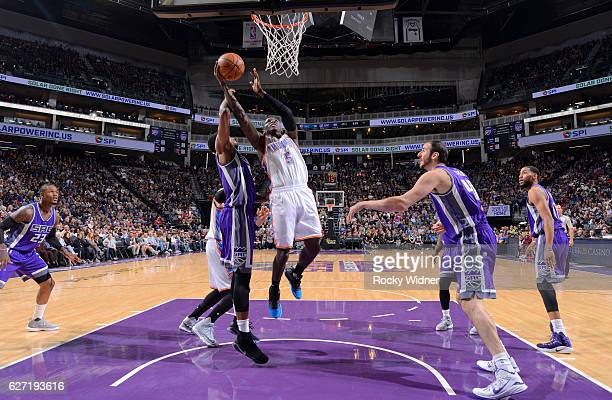 Victor Oladipo of the Oklahoma City Thunder shoots a layup against Rudy Gay of the Sacramento Kings on November 23, 2016 at Golden 1 Center in...