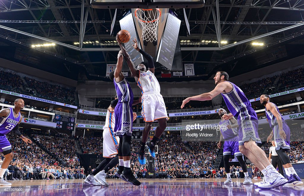 Victor Oladipo #5 of the Oklahoma City Thunder shoots a layup against the Sacramento Kings on November 23, 2016 at Golden 1 Center in Sacramento, California.