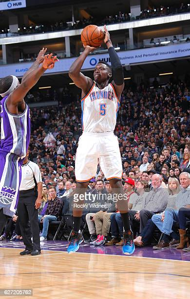 Victor Oladipo of the Oklahoma City Thunder shoots a three pointer against the Sacramento Kings on November 23 2016 at Golden 1 Center in Sacramento...