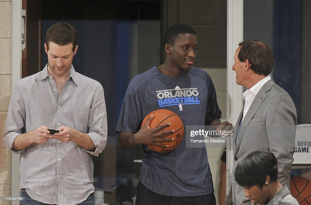 Victor Oladipo #5 of the Orlando Magic confers with staff at the game during the 2013 Southwest Airlines Orlando Pro Summer League game between the Oklahoma City Thunder and the Houston Rockets on July 12, 2013 at Amway Center in Orlando, Florida.
