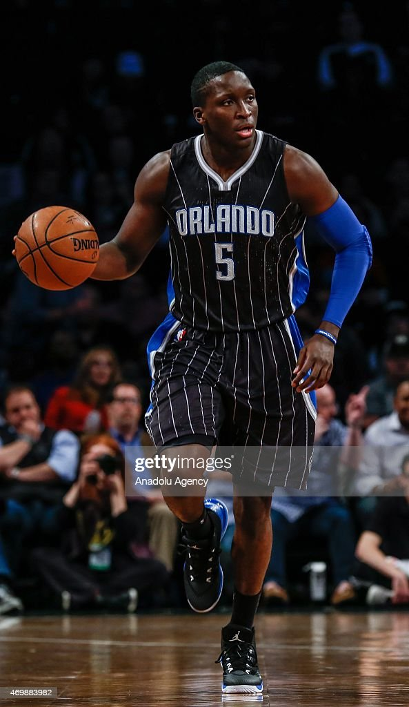 Victor Oladipo (5) of the Orlando Magic handles the ball against the Brooklyn Nets during an NBA basketball game at the Barclays Center in the Brooklyn borough of New York City on April 15, 2015.