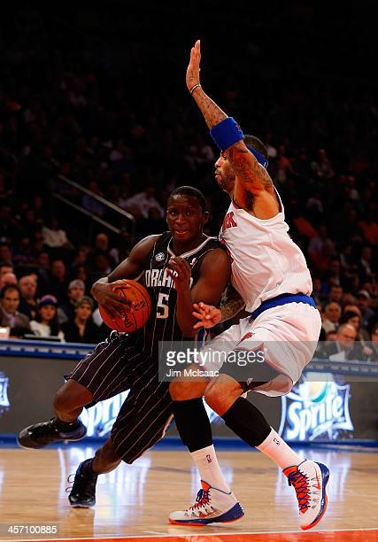 Victor Oladipo of the Orlando Magic in action against Kenyon Martin of the New York Knicks at Madison Square Garden on December 6 2013 in New York...