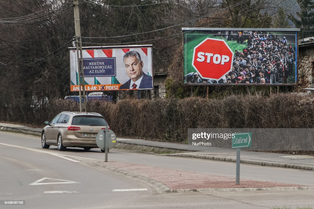 Victor Orban electoral poster together with official government anti-immigrants banner is seen in Miskolc, Hungary on 31 March 2018 According Hungarian media Victor Orban electoral posters are illegal as has no clearly designation of the source of origin, as the election material of the Hungarian government or the Fidesz political party