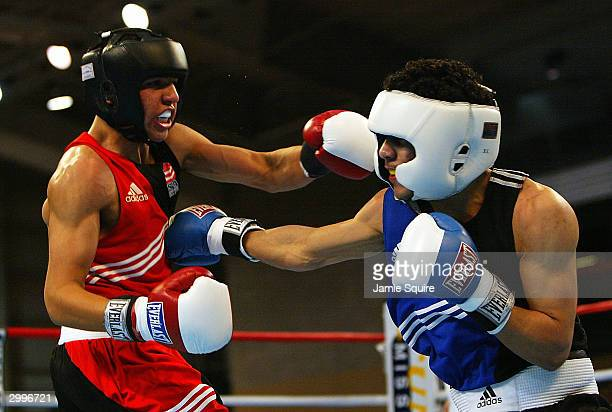 Victor Ortiz and Miguel Gonzalez in action during their bout in the United States Olympic Team Boxing Trials at Battle Arena on February 19 2004 in...