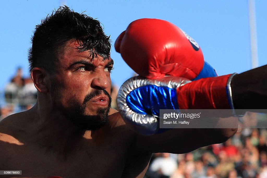 Victor Ortiz avoids a punch by Andre Berto during a welterweight fight at StubHub Center on April 30, 2016 in Carson, California.